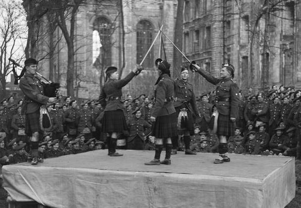 Highland Dance by men of the 810th (Service) Battalion, The Gordon Highlanders outside Arras Cathedral, 24 January 1918 IWMc