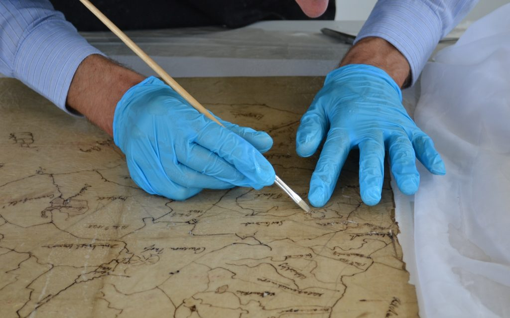5. Brush with nitrile gloves