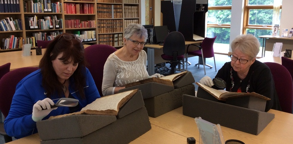 Handling records with cotton gloves at Highland Archive Centre