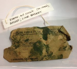 An old packing label found at the bottom of a basket, now placed in a conservation grade wallet and kept with the new object label