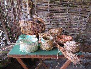 Some of Elaine's straw-work baskets on show in the demo barn up at the township