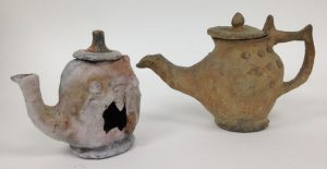 Rachael's fabulous teapot next to the original. The hole appeared very early on in the firing; it probably exploded due to the concentrated heat on the relatively thin clay walls