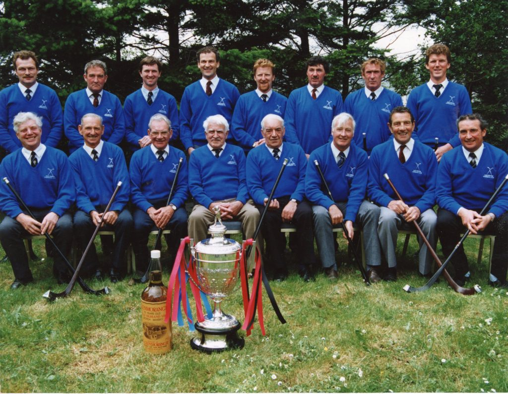 Newtonmore Camanachd Cup Winning Captains, gathered together at the Camanachd Association Centenary Cup Final day, 1996, in Fort William. Image courtesy of High Life Highland, Highland Folk Museum