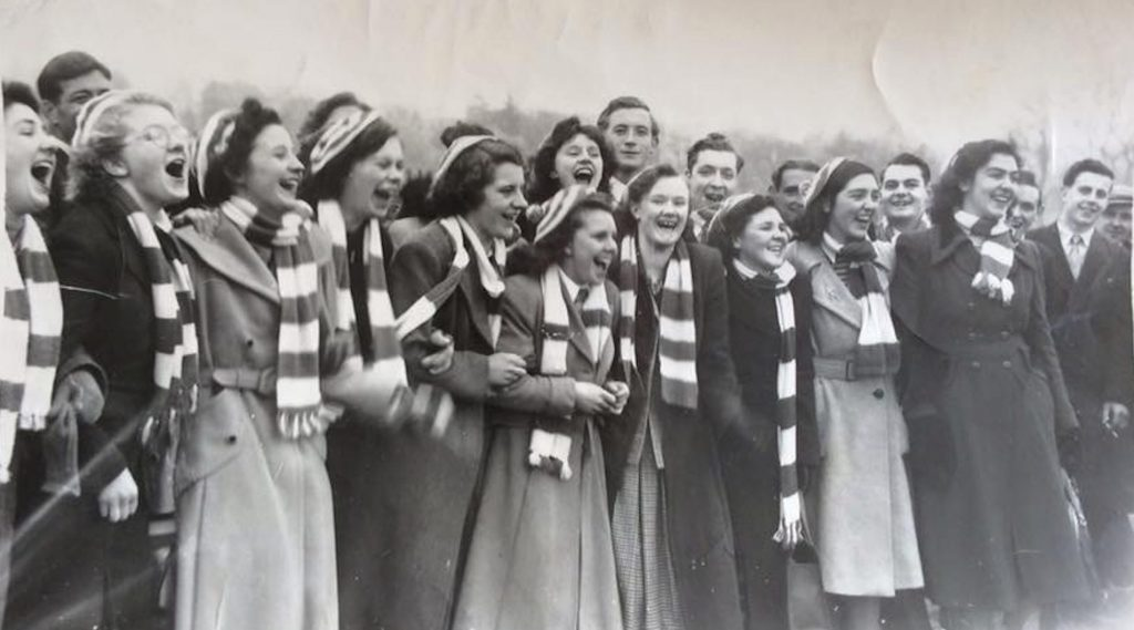 Newtonmore supporters cheering at a match, 1951. Image courtesy of Hugh Dan MacLennan/Jack Richmond Collection
