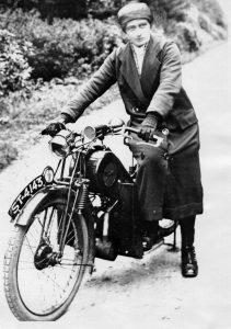 District nurse Flora Ferguson astride her motorbike.
